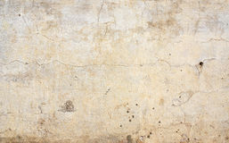 Old stucco wall texture of beige color Stock Images