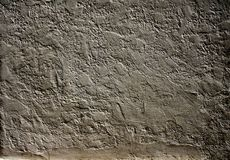 Old stucco wall texture of dark gray color. Grunge background with old stucco wall texture of dark gray color Royalty Free Stock Photos