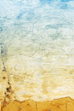Old stucco wall texture of yellow and blue colors Stock Photography
