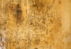 Old stucco wall texture of yellow color Stock Photography