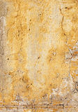Old stucco wall texture of yellow color Royalty Free Stock Photos