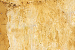 Old stucco wall texture of yellow color Stock Photos