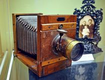 Old studio camera. Wooden large format camera with focusing fur and portrait lens stock photo
