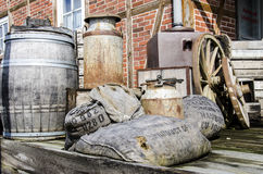 Old stuff from barn. Vintage - Nostalgia - Farm - Metal barrel, wooden boxes, fruit cases, grain bags and other old stuff Stock Photo