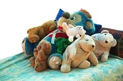 Old stuffed animals on a bed Stock Photography