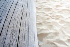 old stump on sand beach, wooden surface texture Stock Photos