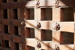 An old sturdy timber portcullis gate or door royalty free stock image