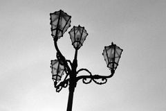 An old-styl street lamp in B&W. Above the sky Royalty Free Stock Images