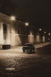 Old style. Old car on the empty night street Stock Image