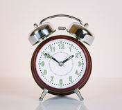 Old style alarm clock isolated. Royalty Free Stock Photos