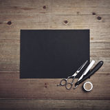 Old style barber tools and black page Stock Photos