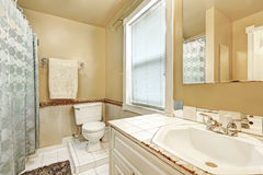 Old style bathroom interior with white tile floor Royalty Free Stock Images