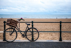 Old style bicycle with basket on coast of the North Sea in The Hague, Netherlands Stock Images
