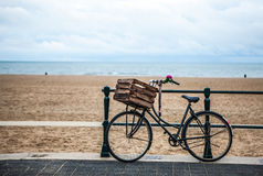 Old style bicycle with basket on coast of the North Sea in The Hague, Netherlands Stock Photography