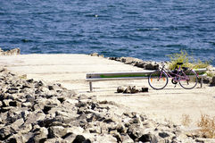 Old style bicycle on the embankment Royalty Free Stock Photo