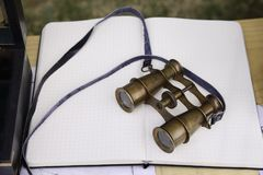 Old Style Binoculars. On graph paper with a strap Stock Images