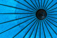 Old style blue umbrellas Stock Photo