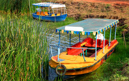 Old style boats in small lake in India Stock Photo