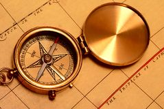 Old style brass compass Stock Photos