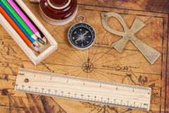 Old style brass compass and color pencil on  map Stock Image