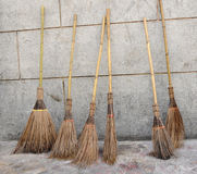 Old-style brooms. Six old-style brooms in a row, Bangkok, Thailand Royalty Free Stock Images