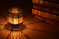 Old-style candlestick with flaming candle Stock Photo