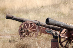 Old style cannons. On the autumn field background Royalty Free Stock Images