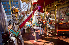 Old-style carousel with ponies Royalty Free Stock Photo