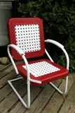 The red patio chair. This old style chair was freshly painted and appears brand new Royalty Free Stock Photos