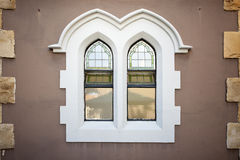 Old style church windows in brown wall Royalty Free Stock Photos