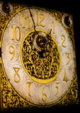 Old Style Clock Face. An old style clock face with intricate gold design Stock Photography