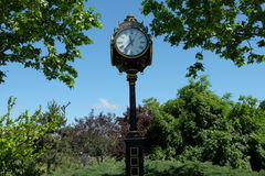 Old style clock. A municipal street clock in Unirii Square in Bucharest, Romania stock photos