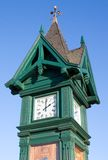 Old style clock tower. Old style wooden clock and weather tower Royalty Free Stock Image