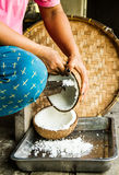 Old style coconut milk making Stock Photo