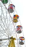 Old style colorful Ferris wheel on white background stock images