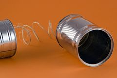 Old Style Communication. The first telephone - two cans and string Royalty Free Stock Photography