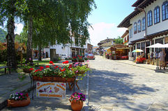Old style crafts street,Tryavna Bulgaria. Traditional outdoor cafe tables beautifully decorated,shops workshops and taverns on pavement at main crafts street royalty free stock photo