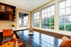 Old style dining room with wood dining table set and wicker chai Royalty Free Stock Photos