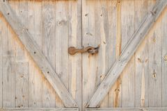 Old style door. Old style wooden door with lock Stock Images