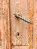 Old style Door Handle. A XIX century, possible older, door handle of a wooden pink-saumon door in the old downtown area of Sibiu, Transylvania, Ro Stock Image