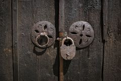 Old style door lock. Old style door with old and rusty padlock in the historic town of Koprivshtitsa, Bulgaria Royalty Free Stock Photography
