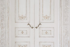 Old-style door, white - handle closeup. antiques interior Stock Photo