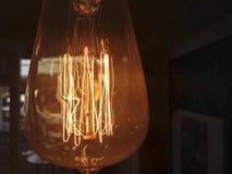 Old style dusty light bulb Stock Photo