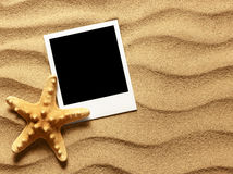 Old style empty photo card on sea sand sunny background Royalty Free Stock Photography