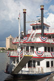 Old Style ferry in Savannah, Georgia. Savannah, Georgia - August 2015: old style ferry, decorated with colors of american flag, at the dock Stock Photo