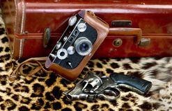 Old Style Film Camera and pistol for safari. royalty free stock photo
