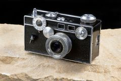Old Style Film Camera. Old style film rangefinder camera sometime called the brick camera Stock Photo