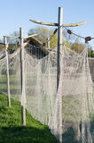 Old style fishing net hanging to dry closeup Stock Photography