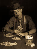 Old style gambler with money and cigar Stock Photo