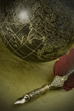 Old style globe and pen Royalty Free Stock Photography
